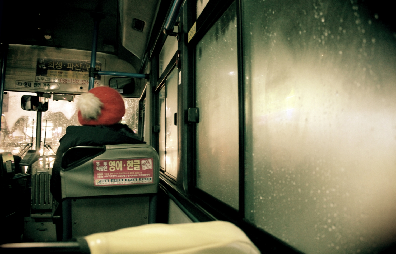 Bus journey on a rainy night in Seoul, South Korea